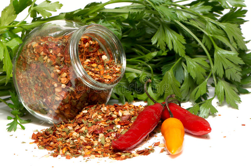 Download Dry Seasoning With Chillies And Parsley Stock Image - Image of isolated, green: 10026845