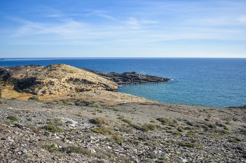 The dry semi-desert meets the Mediterranean in southern Spain. The dry semi-desert of southern Spain meets the blue water of the mediterranean with the small stock image