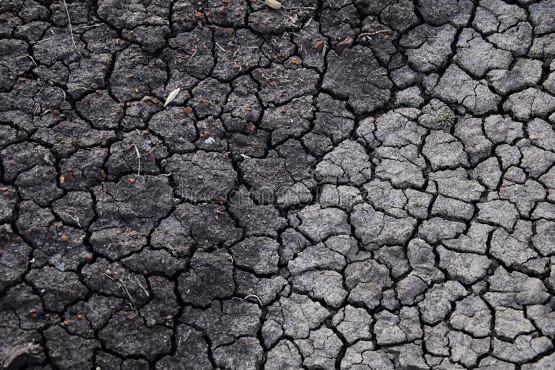 Dry soil abstract background. Drought. Gray dry soil. Soil background. Cracked soil background. Earth pattern. Soil texture. Crack stock photo