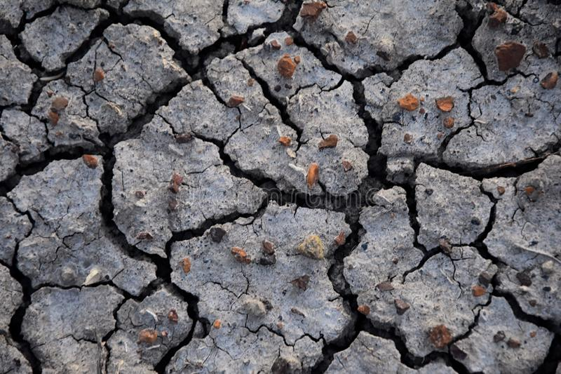 Dry soil abstract background. Drought. Gray dry soil. Soil background. Cracked soil background. Earth pattern. Soil texture. Crack royalty free stock images