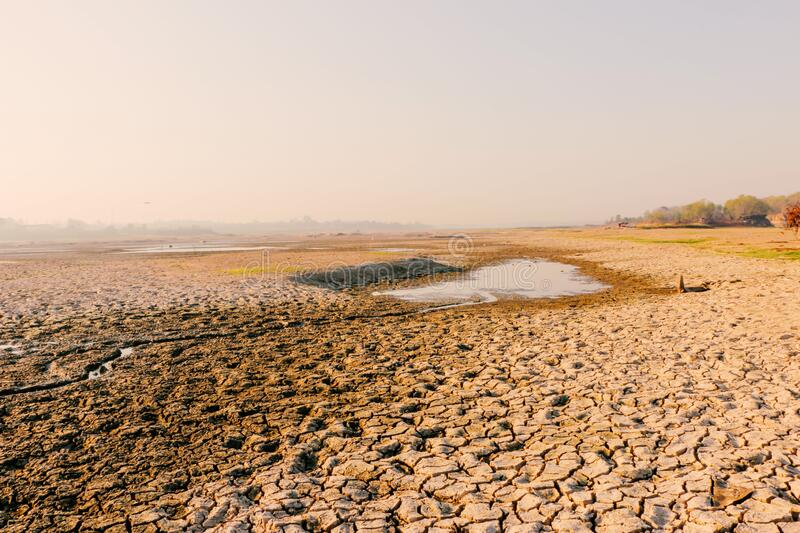 Dry soil due to water reduces natural disasters Global Warming stock photos