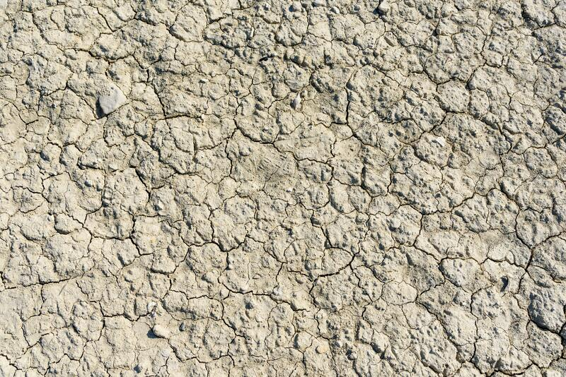 Dry soil texture with crack pattern stock photography