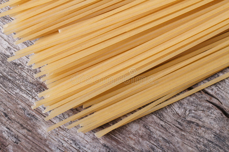 Dry spaghetti on the old wooden table royalty free stock image