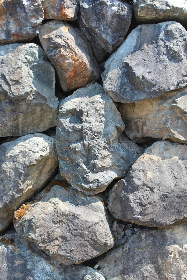 Dry stone boulder retaining wall vertical stock images