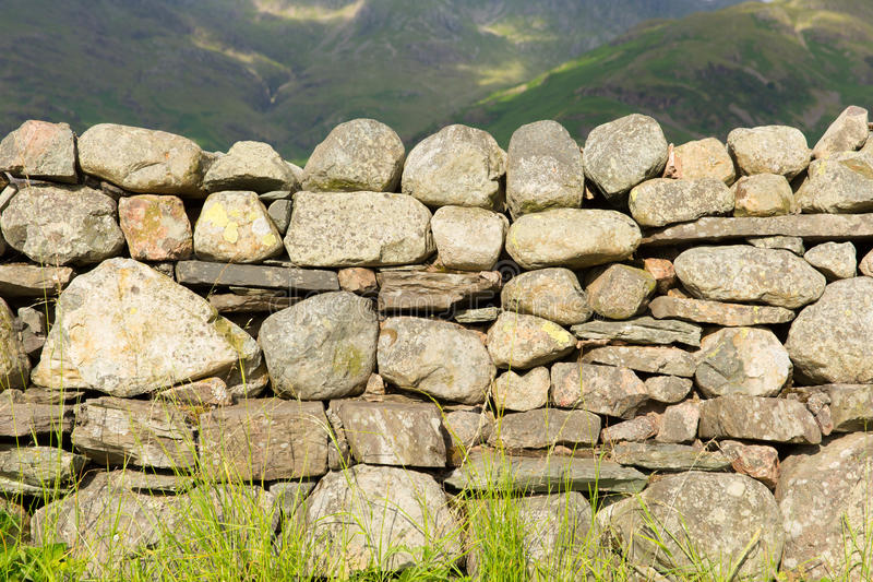 Dry stone wall with no mortar from north of England in the Lake District National Park Cumbria. Dry stone wall in the north of England countryside in the Lake stock photo