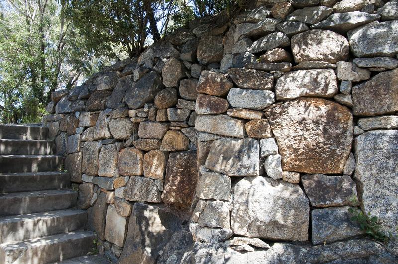 Dry stone wall in parkland. Springtime in the garden Albany, Australia stock photography