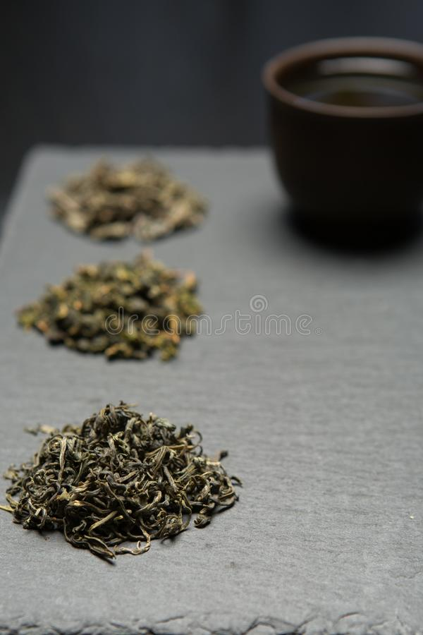 Dry tea collection of different types on black background stock image