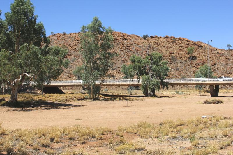 Dry Todd river after a period of dryness, global warming in Alice Springs, Australia. The Todd river in Alice Springs is dry. You can see the bridge over a river royalty free stock photo