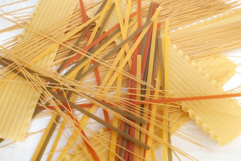 Dry uncooked pasta stock photos