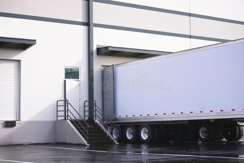 Dry van semi trailer loading and unloading commercial cargo in w royalty free stock image