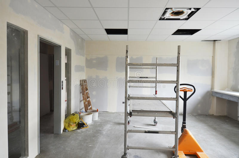 Dry walling. Building site with dry walling and inserted glass stock photography