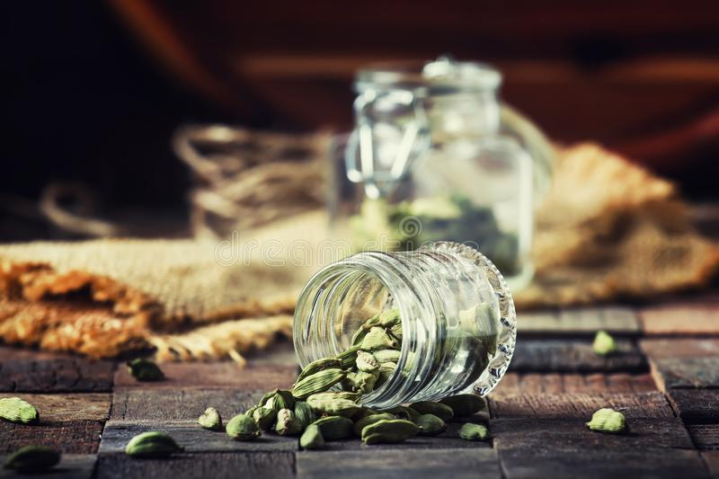 Dry whole cardamom, vintage wooden background, selective focus royalty free stock photo