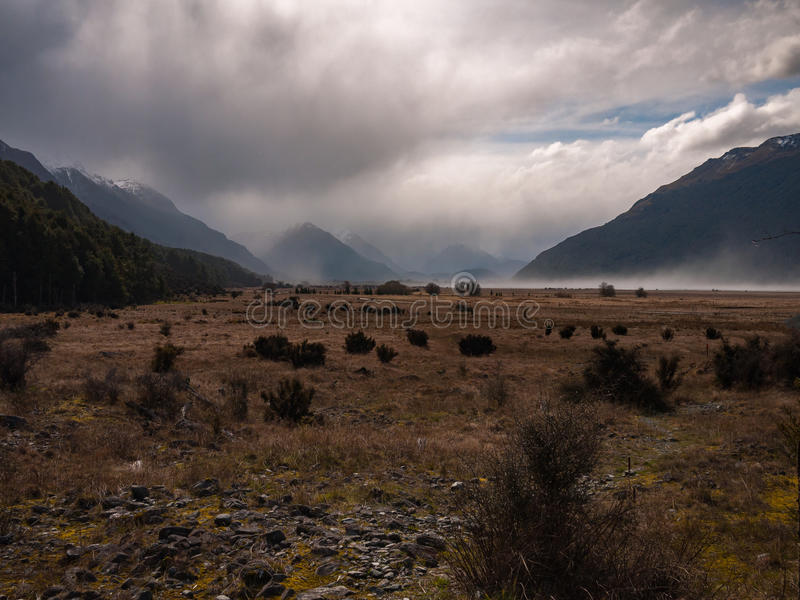 Download Dry Windy Plain Surounded By Mountains Stock Photo - Image: 83715356