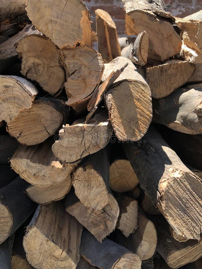 Dry wood stacked in piles. stock photos