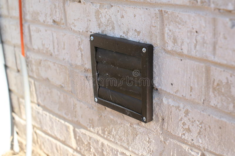 Dryer vent cover. A dryer ventilation cover that is clogged with hair stock image
