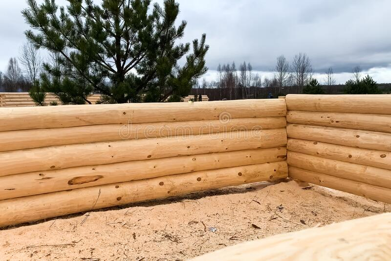 Drying and assembly of wooden log house at a construction base stock images