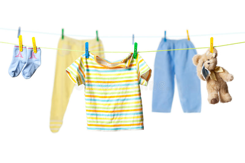Drying baby clothes and a teddy bear stock image