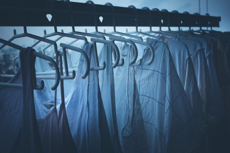 Drying clothes on clothesline on condo in nignt housework and cleaning concepts royalty free stock photography