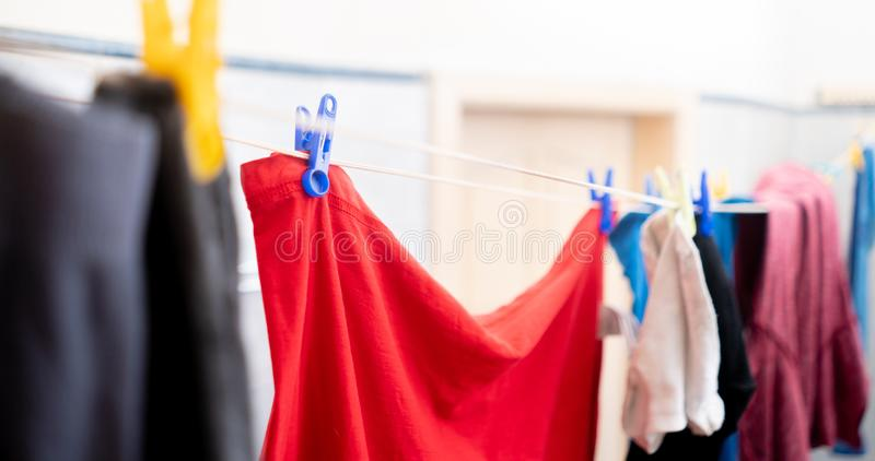 drying the clothes hanging in laundry, hanging after washings royalty free stock images