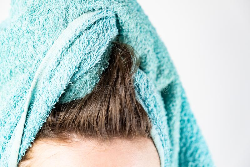 Close-up view of washed hair and bath towel royalty free stock photography