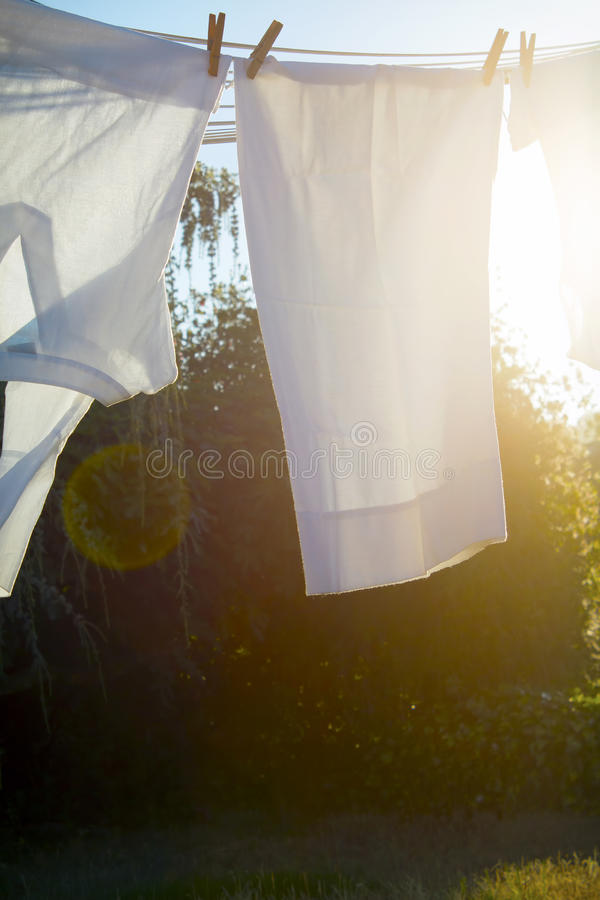 Drying laundry in the sun stock photography