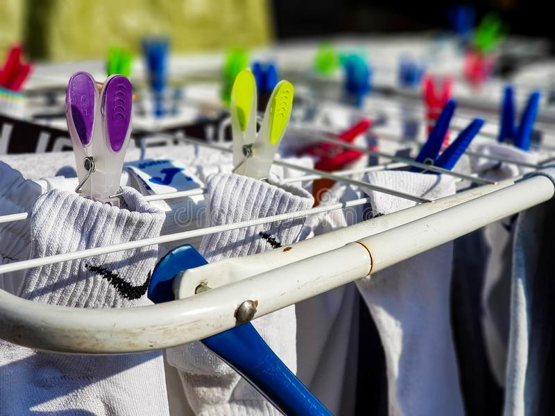 Drying Nike socks on clothes horse , shallow depth of field. royalty free stock image