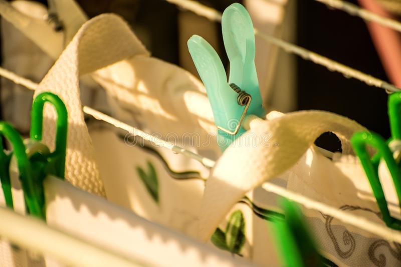 Drying rack on a balcony with raindrops royalty free stock image