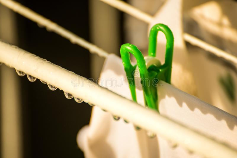 Drying rack on a balcony with raindrops royalty free stock photo