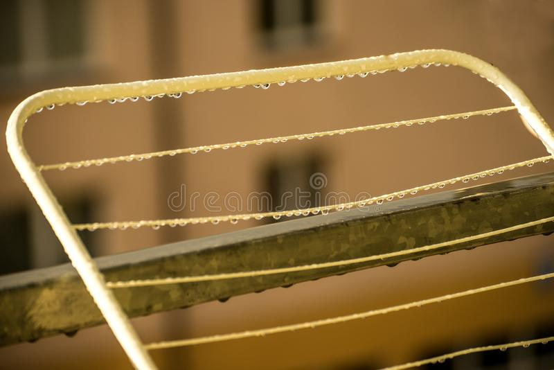 Drying rack on a balcony with raindrops stock photo