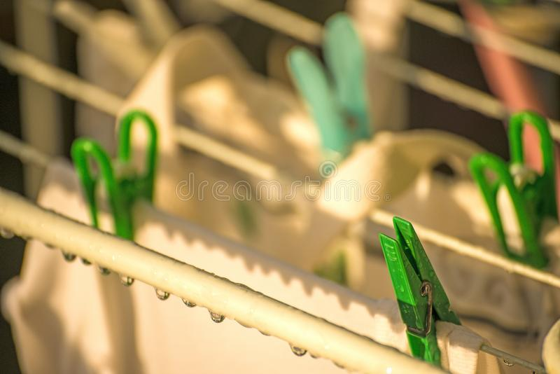 Drying rack with raindrops royalty free stock image