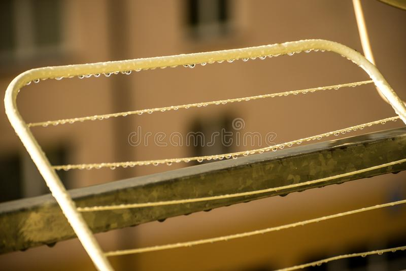 Drying rack with raindrops royalty free stock photography