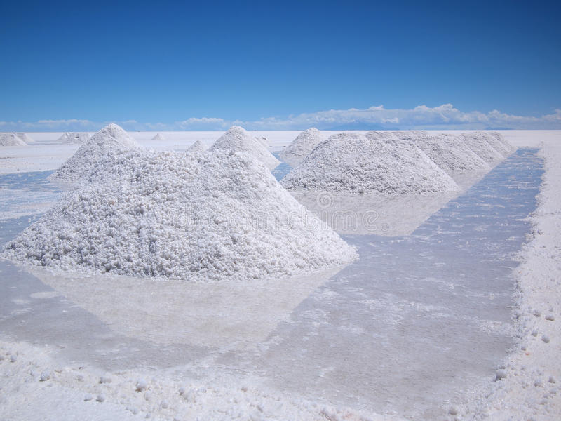 Drying salt piles on the Salar de Uyuni stock images