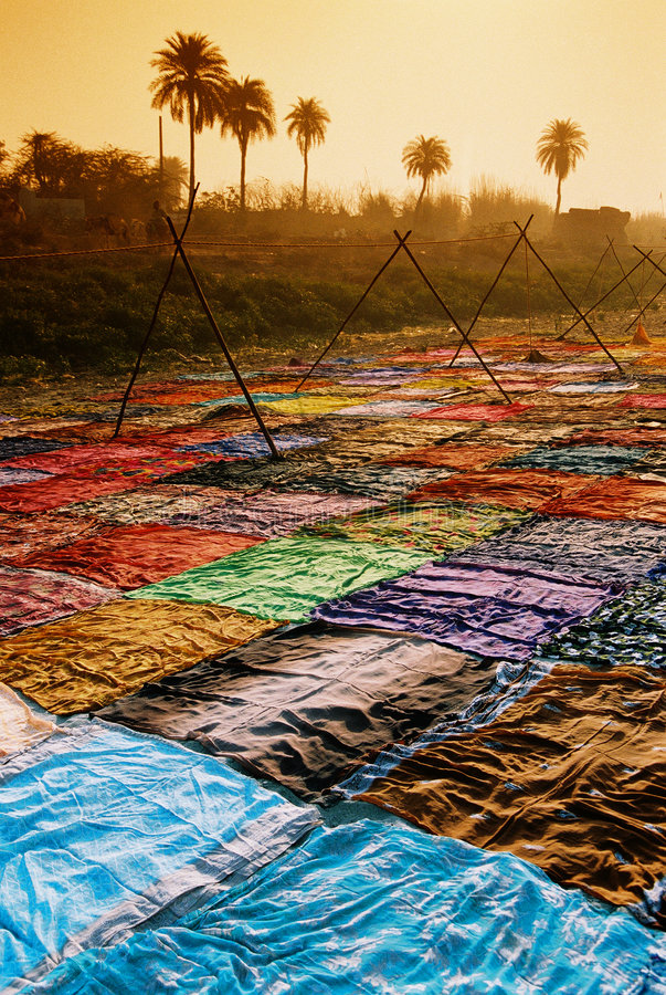 Drying sari, India. Colorful sari are dryed on the bank of river Yamuna near Agra in India royalty free stock photography