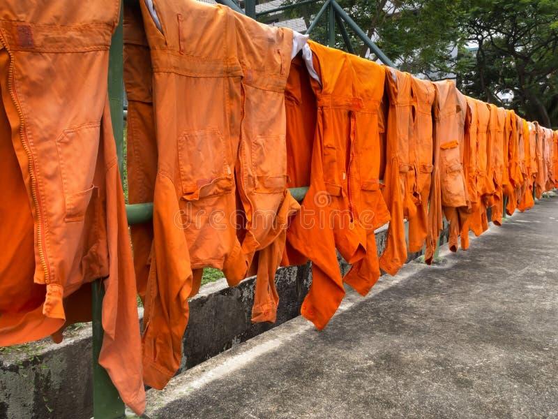 Drying uniforms beside pavement