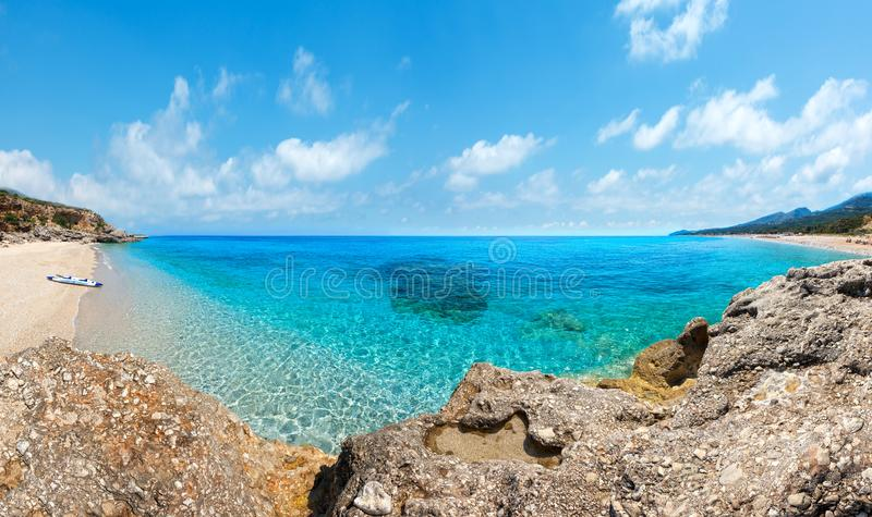 Drymades beach panorama, Albania. Drymades beach view, Albania. Summer Ionian sea coast view with inflatable canoe on shore royalty free stock photos