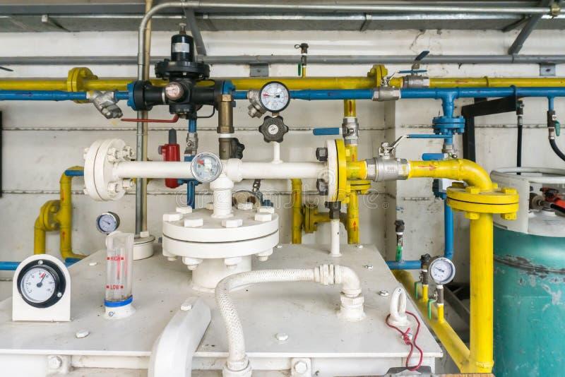 Drymba i klapa LPG gazu przeszczep przy LPG benzynową stacją fotografia stock