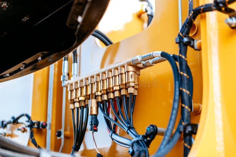 Drymby i tubki hydrauliczny system nowożytny ekskawator tr zdjęcie royalty free