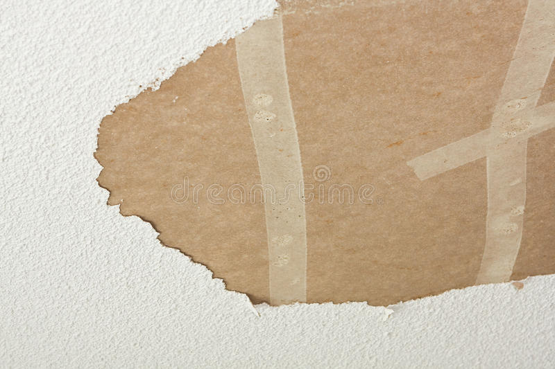 Drywall ceiling with acoustic missing. An area of acoustic ceiling was scraped off revealing the drywall beneath stock images