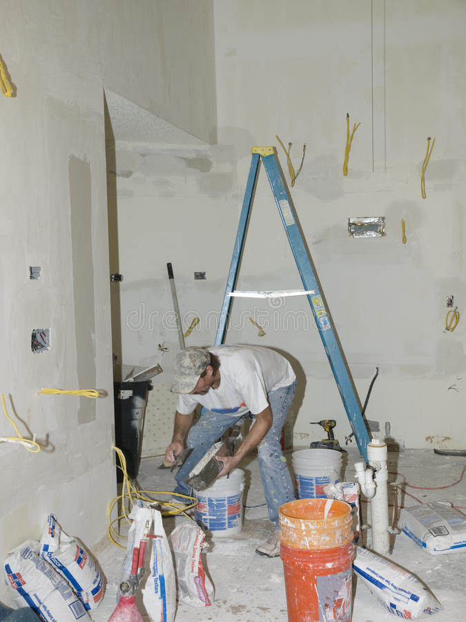 Drywall finishing a knocked down surface stock images