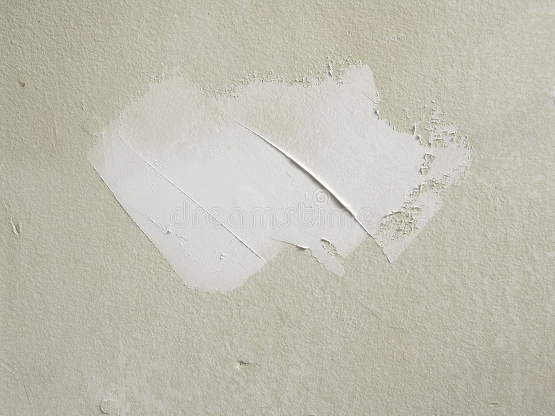 Drywall mud. For patch over hole in wall stock image