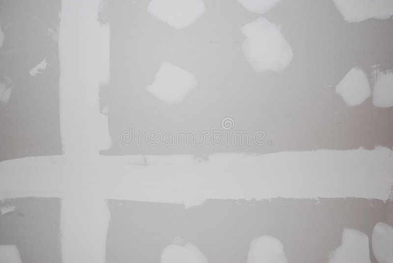 Drywall texture. A sheetrock or drywall background. The taping and spackling have been done in this shot stock images