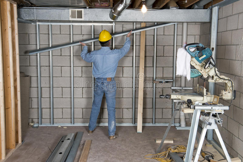 Drywall van het Manusje van alles van de Contractant van de bouwvakker stock foto