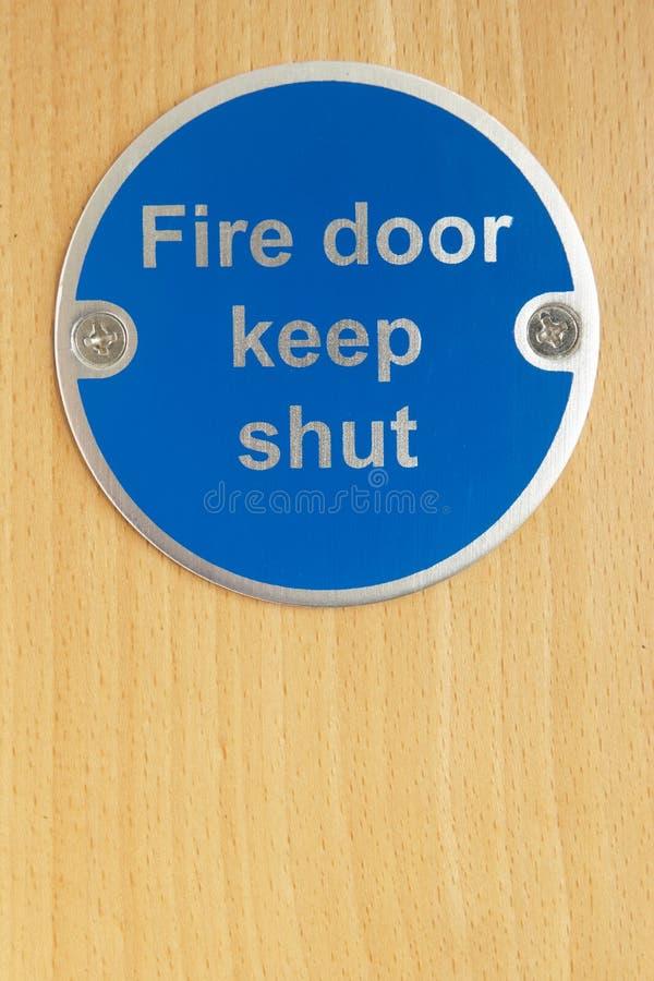 drzwi ogienia utrzymanie zamykający znak obrazy royalty free