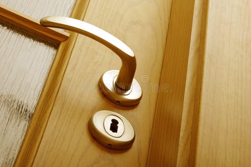 drzwiowej rękojeści kędziorek zdjęcia stock