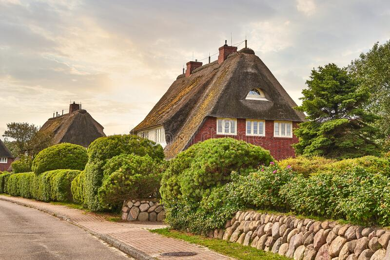 Country house, romantic thatched cottage. stock photo
