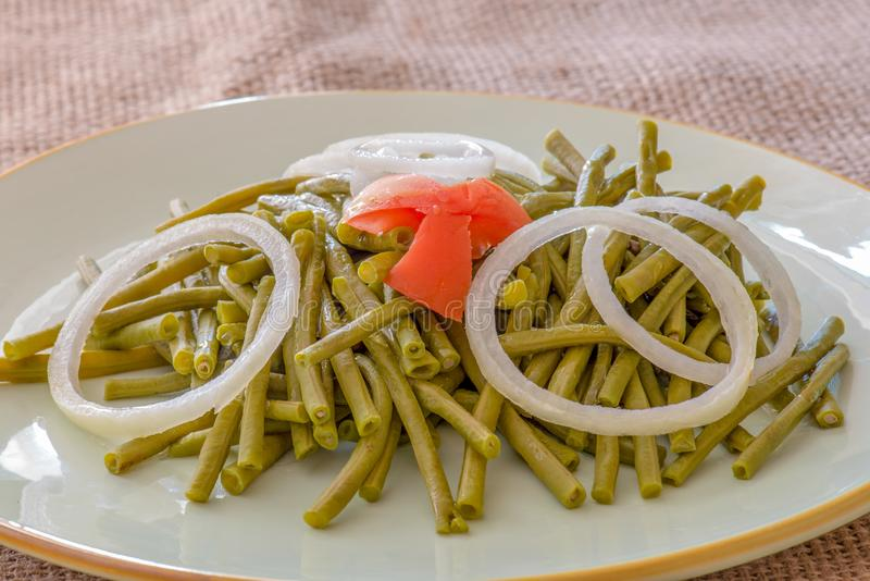 Long Chinese Green Beans Salad. Cooked long Chinese green beans. Delicious salad that only uses oil and vinegar as dressing. The plate is garnished with a star stock photo