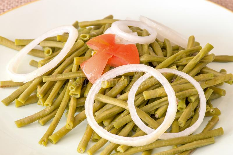 Long Chinese Green Beans Salad. Cooked long Chinese green beans. Delicious salad that only uses oil and vinegar as dressing. The plate is garnished with a star royalty free stock photos