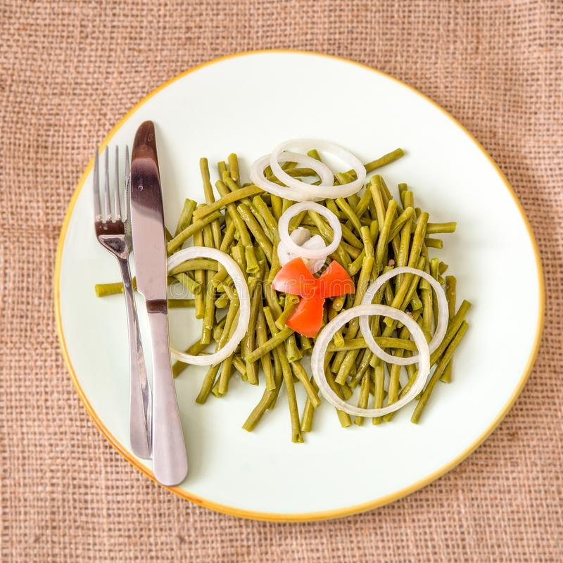 Long Chinese Green Beans Salad. Cooked long Chinese green beans. Delicious salad that only uses oil and vinegar as dressing. The plate is garnished with a star royalty free stock images