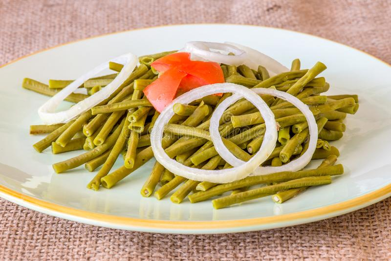 Chinese Long Green Beans Salad. Cooked long Chinese green beans. Delicious salad that only uses oil and vinegar as dressing. The plate is garnished with a star royalty free stock photography