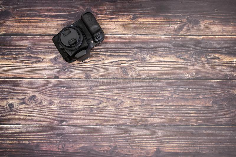 DSL camera on the wooden table.  royalty free stock photo